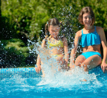 Children playing in a pool representing how a Lake Forest child custody attorney obtained custody of children.