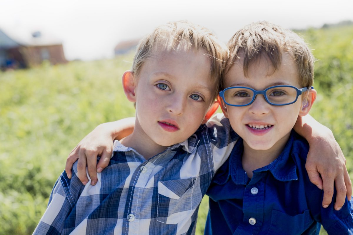 Two young boys in a field having fun represent the need for a qualified Chicago child custody attorney.