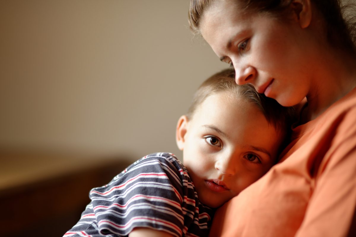A mother sits with her son in a meeting with a Lake Forest divorce attorney.