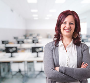 A woman in front of a classroom shows how a Lake Forest divorce attorney can teach you how to move on with your life.