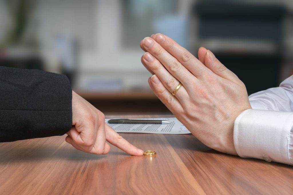 This wife is returning her ring to her husband, as they have just ended their marriage with the help of a Deerfield divorce lawyer.