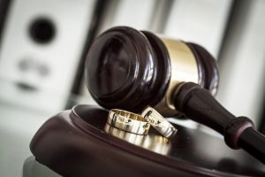 divorce concept with gavel and rings for a divorce lawyer chicago