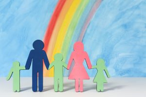 father mother and children with paper and colors for a divorce attorney chicago