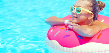 Tween girl enjoying summer by being the pool, and if you have custody issues, call a Chicago Custody Attorney.
