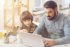 dad and son on computer searching for a divorce attorney evanston