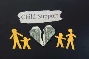 paper family with broken money heart and Child Support text representing work done for chicago child custody attorney