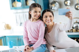 mother and daughter spending time with each to receive the right child support speak with a Cook County Divorce lawyer