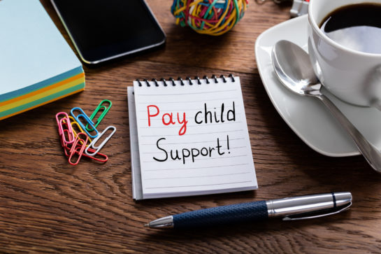 Pay Child Support Concept Written On Notepad