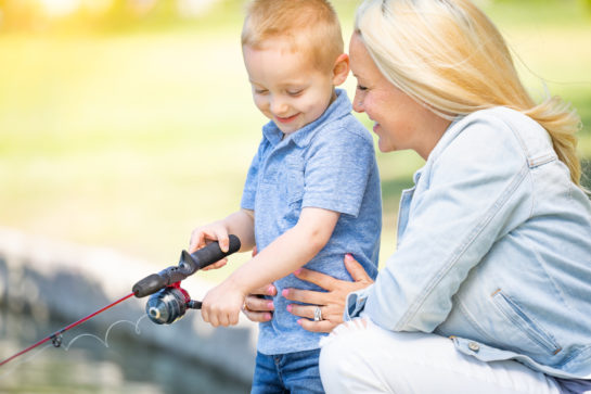 Mother and son making memories by fishing together, for best results with your child custody agreement consult with Chicago parenting time attorney