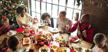 family gathering to celebrate Christmas, if going through divorce seek counsel from an experienced family law attorney in Chicago.