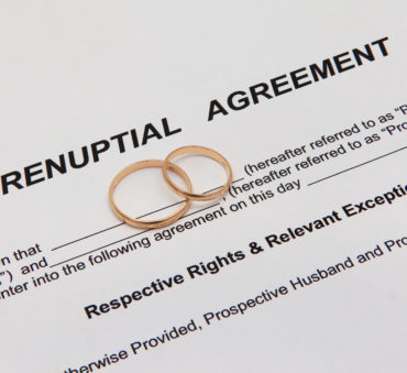 Prenuptial agreement document with weddings rings representing how our Chicago divorce attorney can assist you with creating a prenup agreement