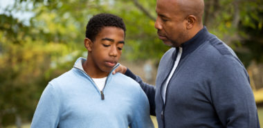 Father talking with his son representing how our Chicago divorce lawyers can assist you on the best ways to discuss divorce with your children.