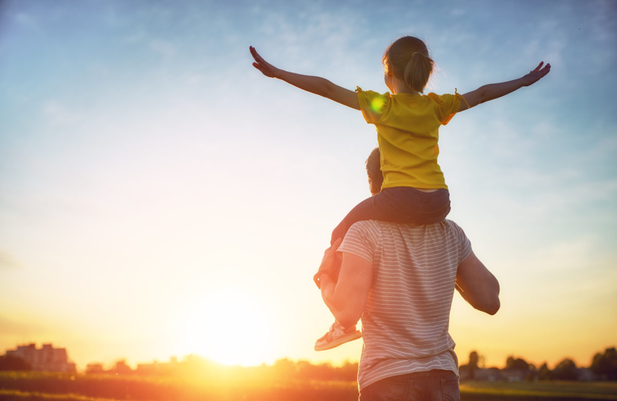 Daughter on father's shoulders representing how our Chicago paternity attorneys can assist you with your family law legal issues
