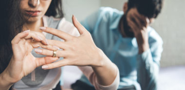 Woman taking off wedding ring representing how our Chicago divorce lawyers can help you with every step of divorce