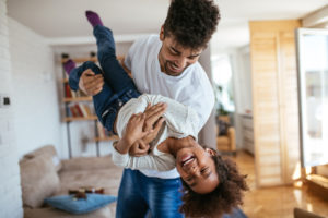 Father playing with daughter representing how our Chicago child custody lawyers can help with your case