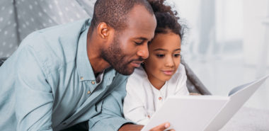 Father and daughter reading together representing how our Chicago child custody lawyers can help you with your custody case