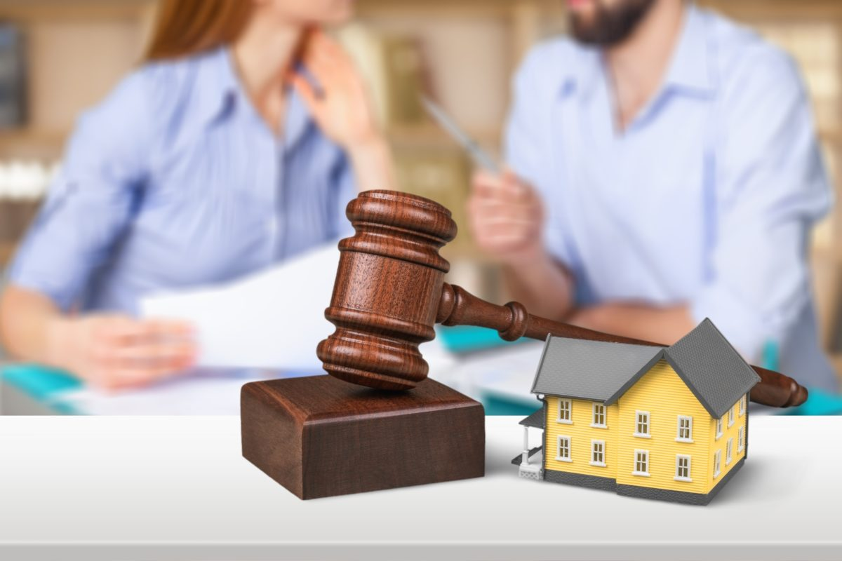 Couple arguing over different aspects complicating their divorce representing how our Chicago divorce attorneys can help you.