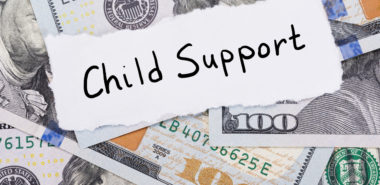 child support with money representing how our Chicago child support lawyers can help you with your child support case