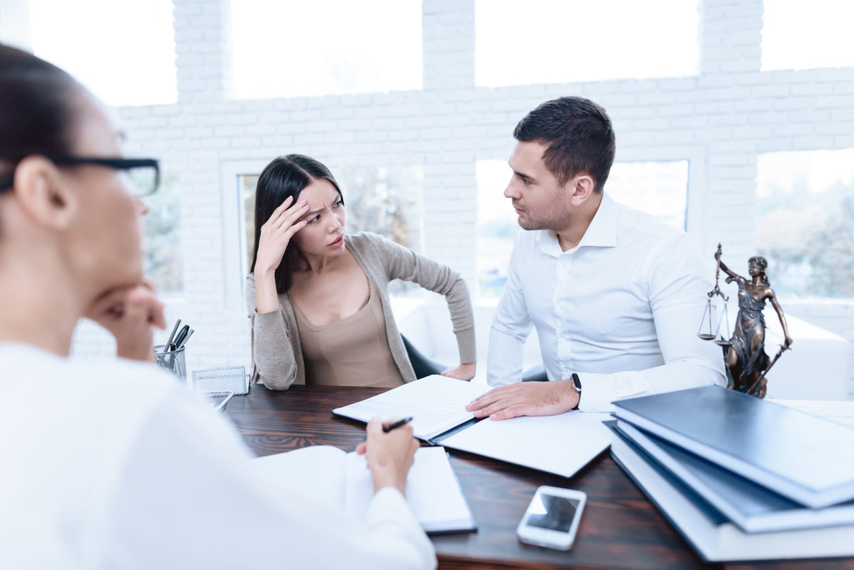 A couple not agreeing at meeting with Good Chicago Divorce Lawyer.