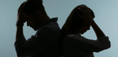 Silhouette of a couple standing back to back upset, when you have marriage problems that cannot be resolved meet with Divorce Settlement Lawyer Chicago.