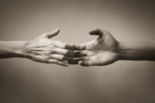Woman and man hand touching but losing connection, for Divorce Lawyers Downers Grove contact our law firm to proceed with filing for divorce.