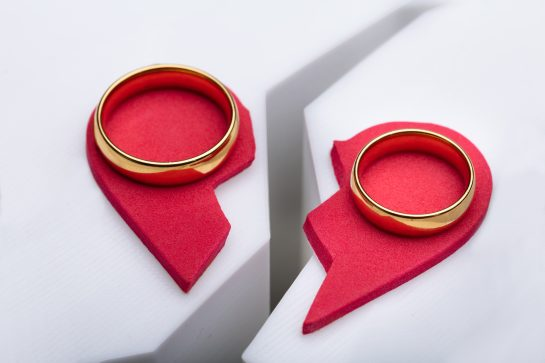 wedding rings on broken red heart, when deciding to end marriage seek advice from experienced Divorce Attorneys Lincolnshire.