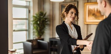 Welcoming Chicago divorce attorney shakes hands with client