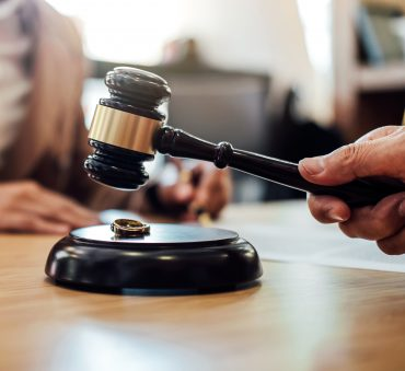 A gavel with wedding rings, schedule a consultation with our Divorce Law Firm in Chicago.