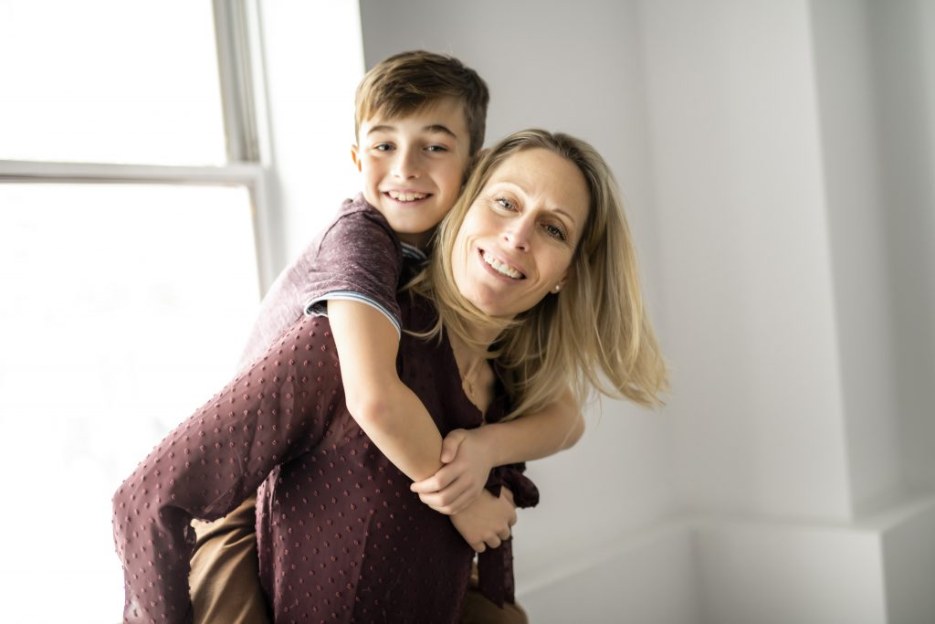 Mother and son spending time together after contacting a Chicago divorce lawyer.
