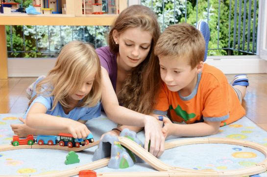 Three children playing with train set, contact our divorce law firm to speak to Child Custody Lawyer Glenview about changes with visitation.
