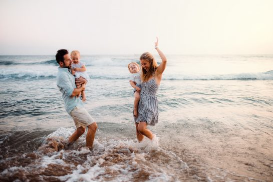 A young family playing in beach concept for Chicago Alimony Calculator when determining spousal support with divorce law firm.