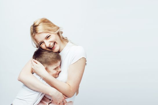 Mother hugging her child, when needing the best Woodbridge Divorce Lawyer.