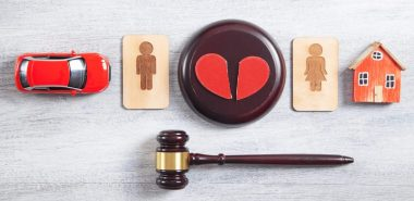 Broken heart with gavel for asset division with divorce concept when needing a Marital Property Division Lawyer Chicago.